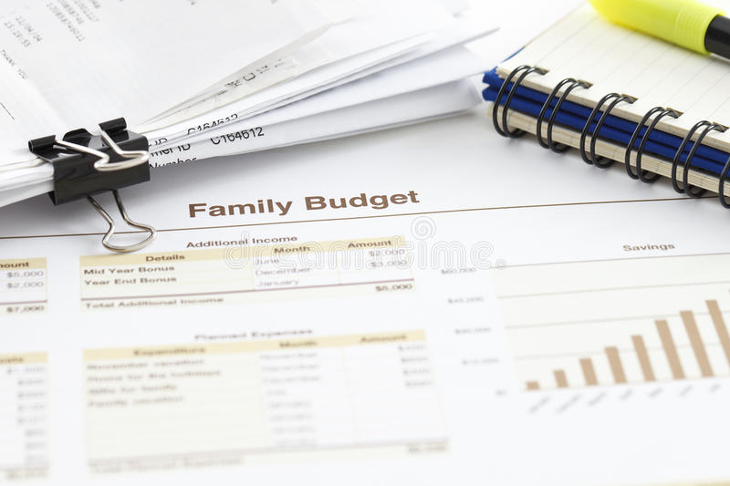 Family Budget. Spreadsheet printout, pile of receipts and a spiral notebook stock photography