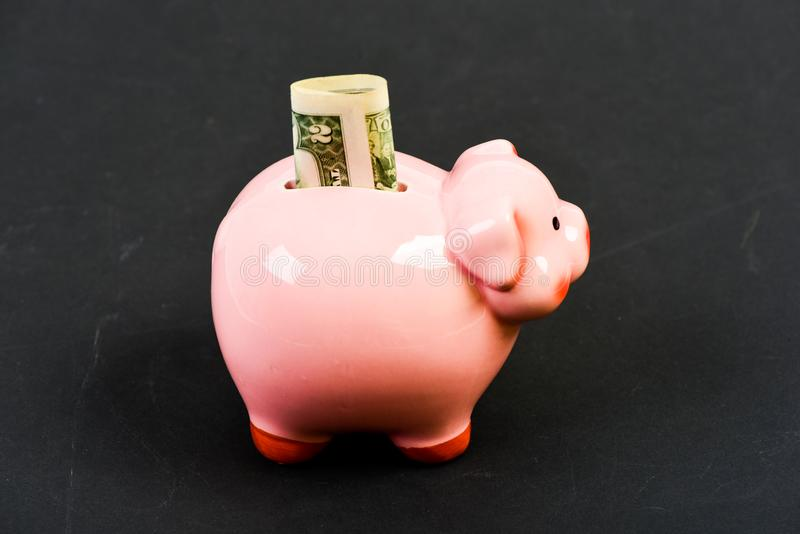 Family budget. business startup. financial position. getting rich. income. saving money. piggy bank with golden coin royalty free stock photo