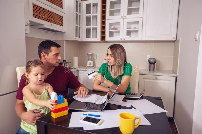 Family budget and finances- couple with daughter planning home b royalty free stock photos