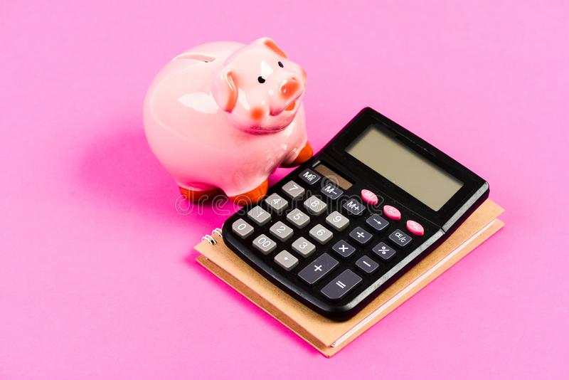 Family budget management. bookkeeping. financial report. piggy bank with calculator. Moneybox. business start up. saving stock photo