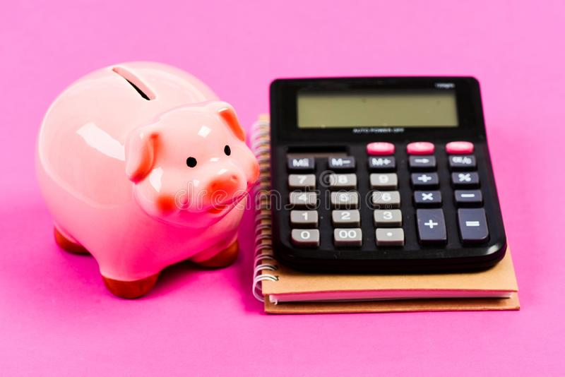 Family budget management. business start up. bookkeeping. financial report. piggy bank with calculator. Moneybox. saving royalty free stock images