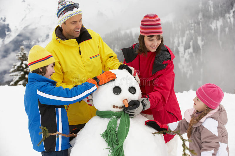 Download Family Building Snowman On Ski Holiday Stock Image - Image: 25645069