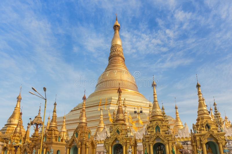 Family burmese people praying respects at Shwedagon big golden pagoda in rangoon, MyanmarBurma stock photo