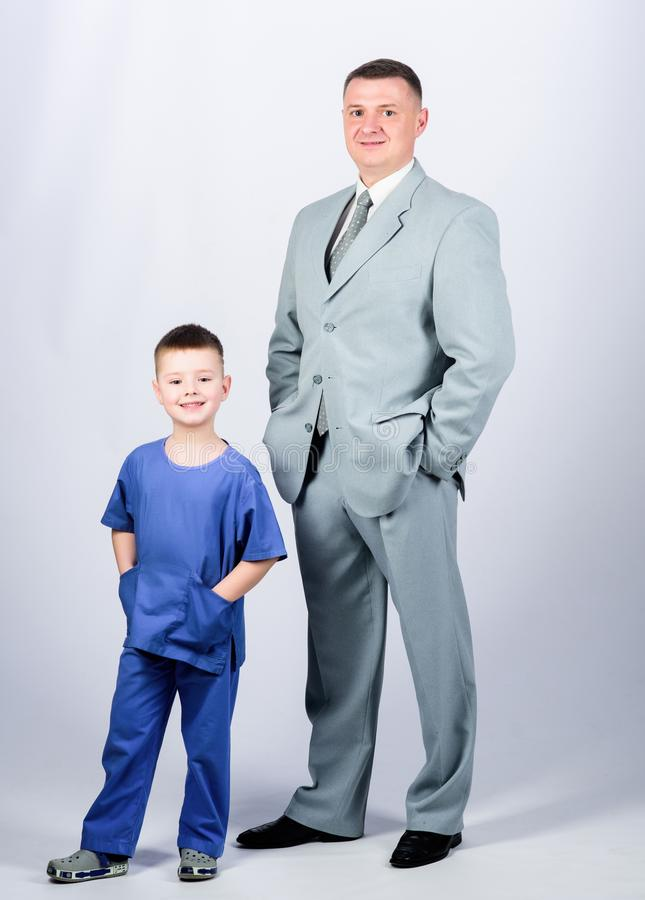 Family business. Doctor respectable career. Dad boss. Father and cute small son. Child care development upbringing. Respectable profession. Man respectable stock photography