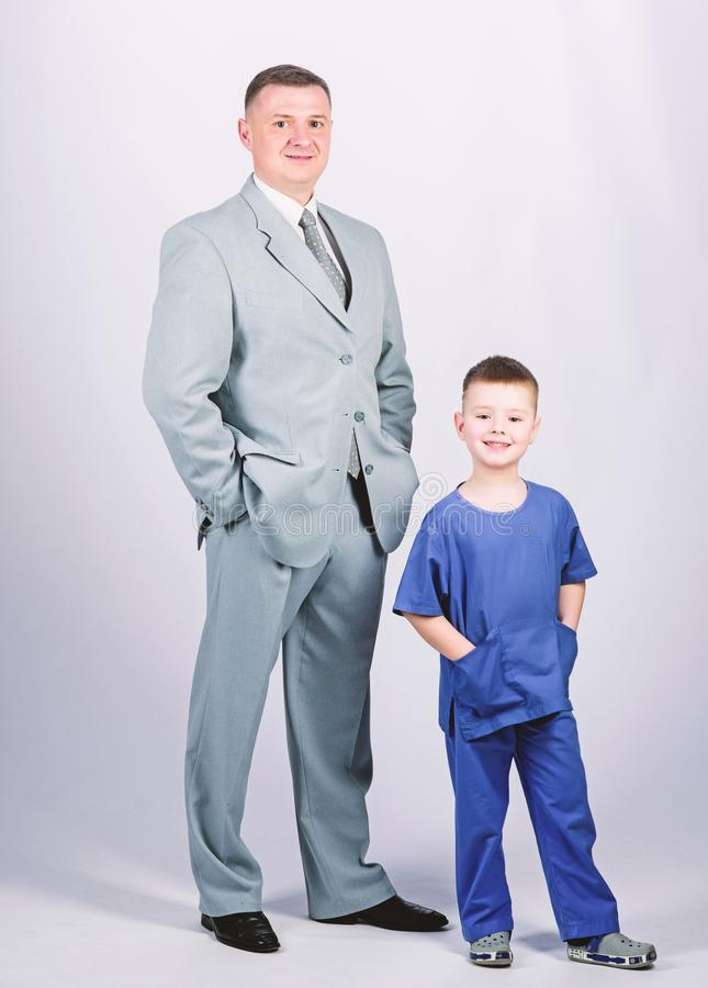 Family business. Doctor respectable career. Dad boss. Father and cute small son. Child care development upbringing. Respectable profession. Man respectable stock image