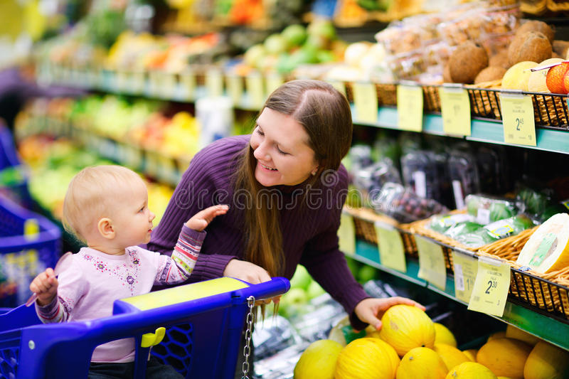 Family buying fruits in supermarket royalty free stock photos