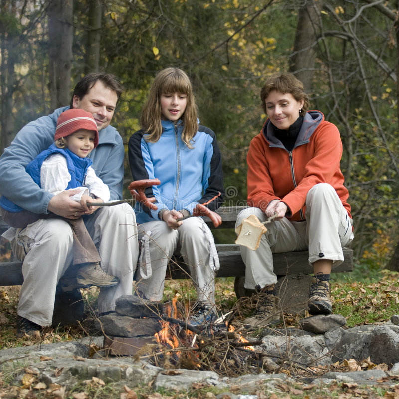 Family in camp. Happy family together near campfire