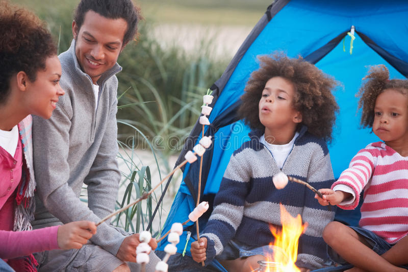 Family Camping On Beach And Toasting Marshmallows stock photography