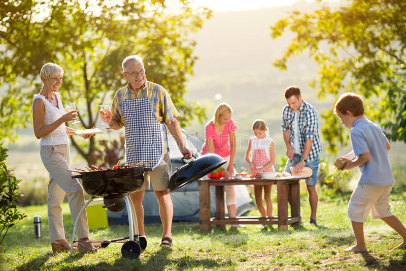 Family camping and cooking stock image