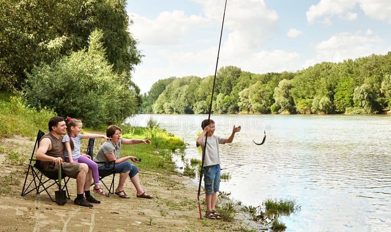 Family camping and fishing, river and forest, summer season royalty free stock images