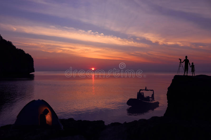 Family camping on the island with private boat. royalty free stock images