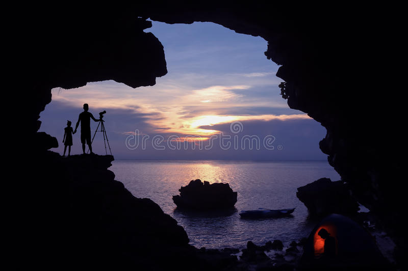 Family camping and kayaking on the beach. stock photography