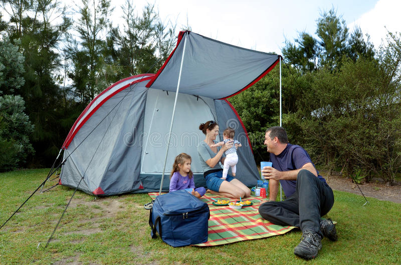 Family camping in a tent outdoors stock photography