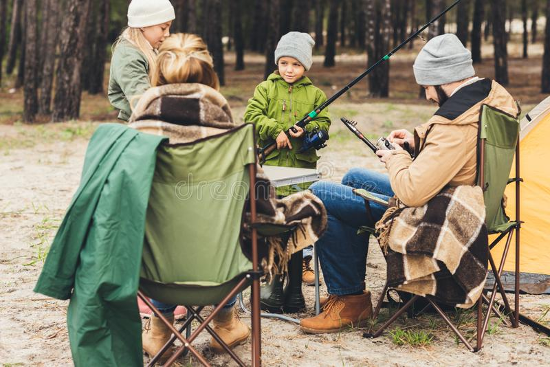 Family with fishing rods. On camping trip stock photo