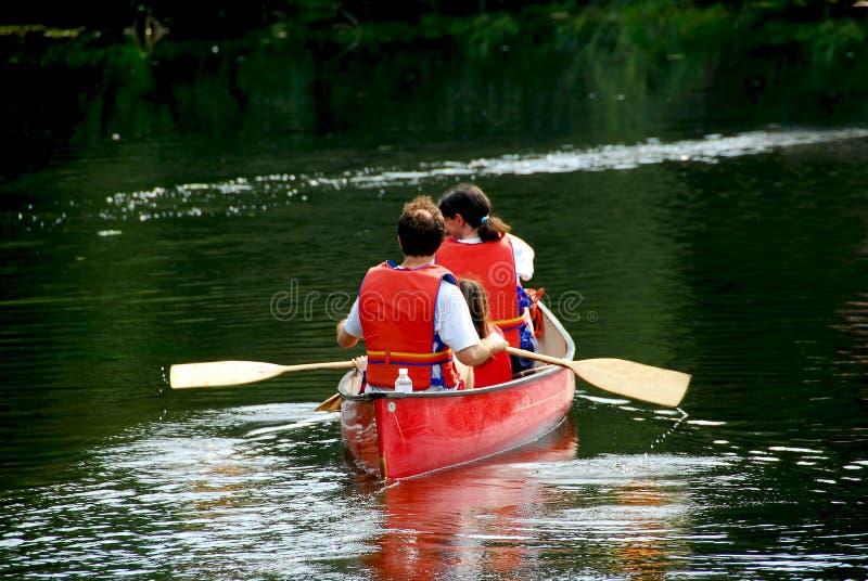 Family canoe river stock images