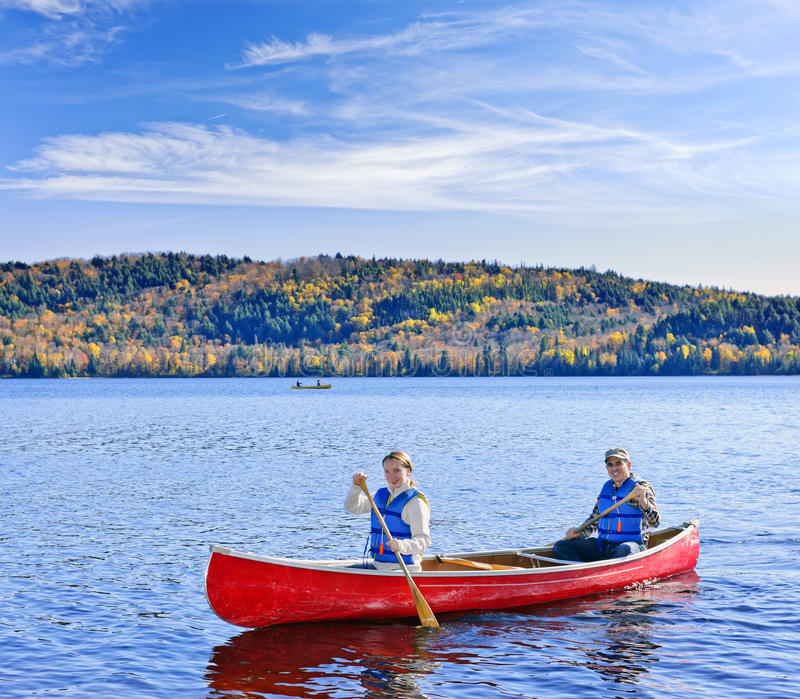Family canoe trip. Father and daughter canoeing on Lake of Two Rivers, Ontario, Canada stock image