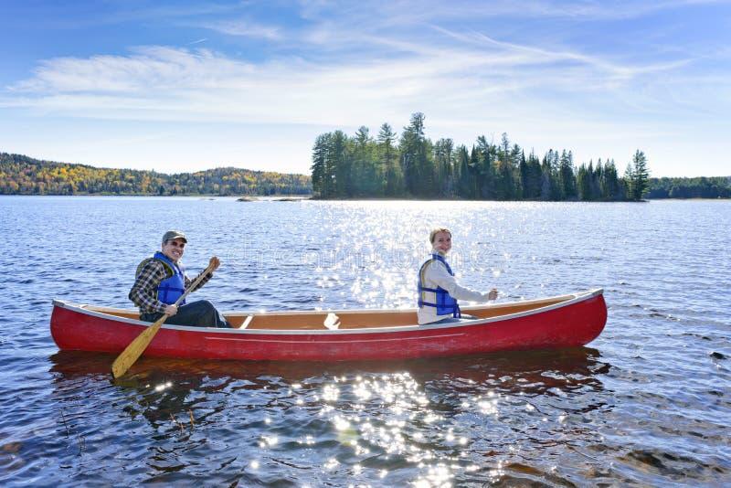 Family canoe trip royalty free stock photo