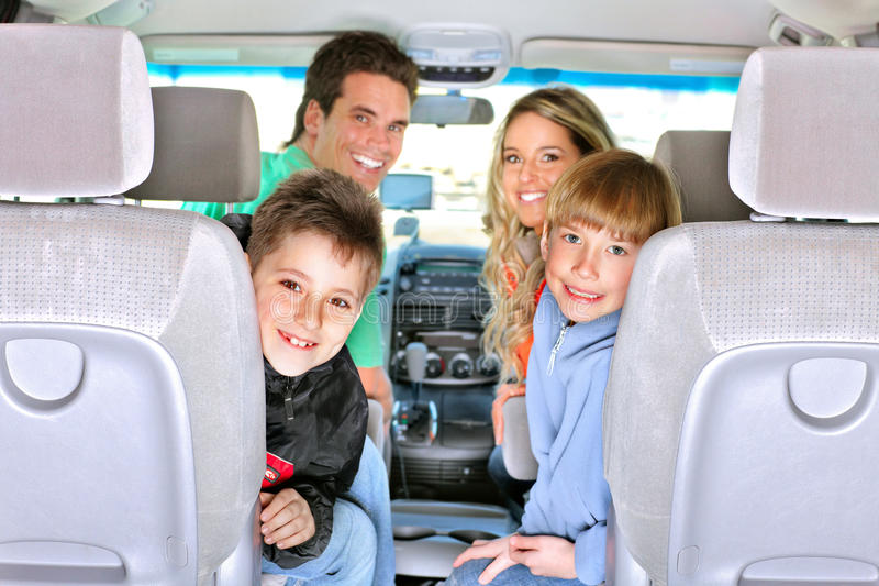 Family car. Smiling happy family in the car