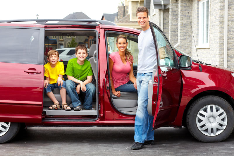 Family car. Smiling happy family and a family car