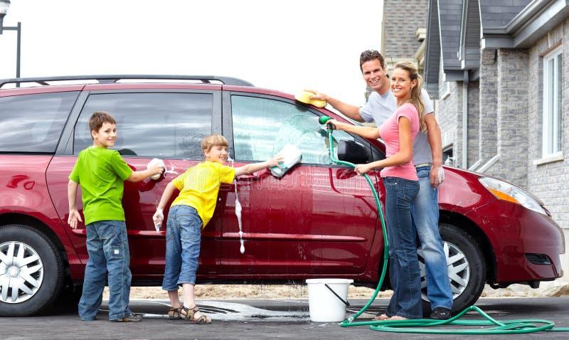 Family car. Smiling happy family washing the family car