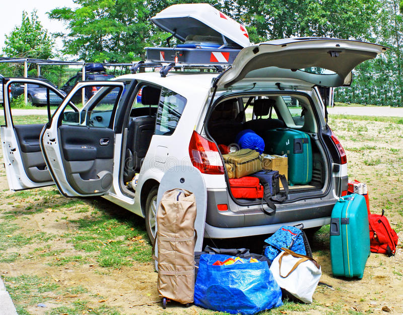 Family Car Loaded With Luggage On Holiday Stock Photos