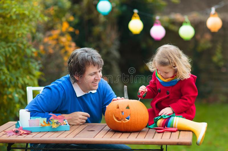 Family carving Halloween pumpkin royalty free stock image