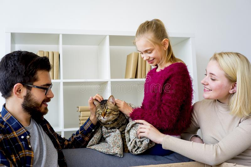 Family with a cat stock photography