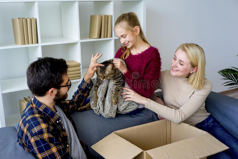 Family with a cat stock photos