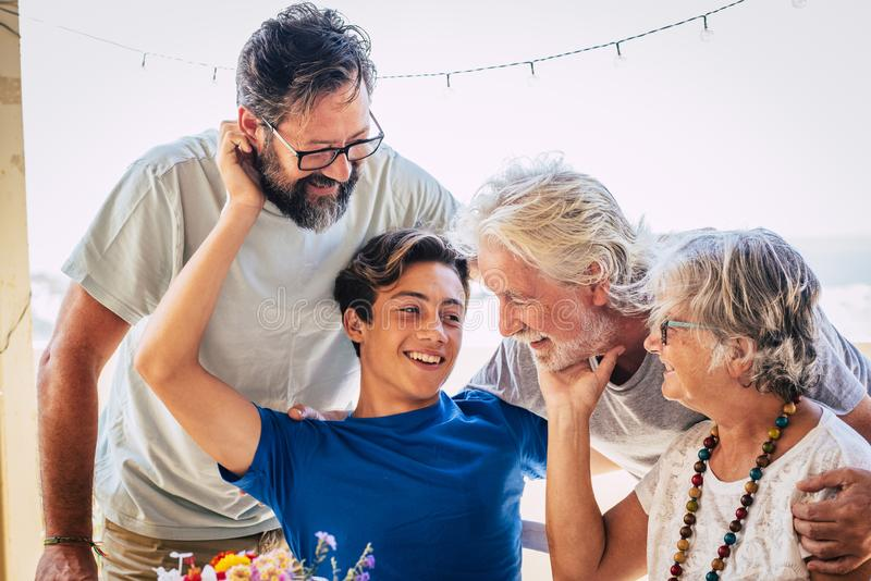Family caucasian portrait of happy cheerful family with three generations from grandson to son and grandfathers all together stock image