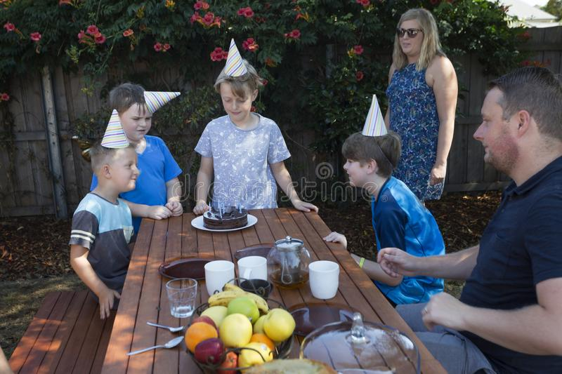 A family celebrates a child`s birthday outdoors. royalty free stock photo