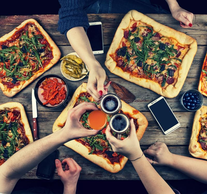 The family celebrates Father`s Day in a cozy home setting.Home food, homemade pizza. Happy family having dinner together while si royalty free stock images