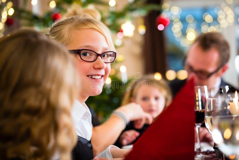 Family celebrating Christmas dinner stock images