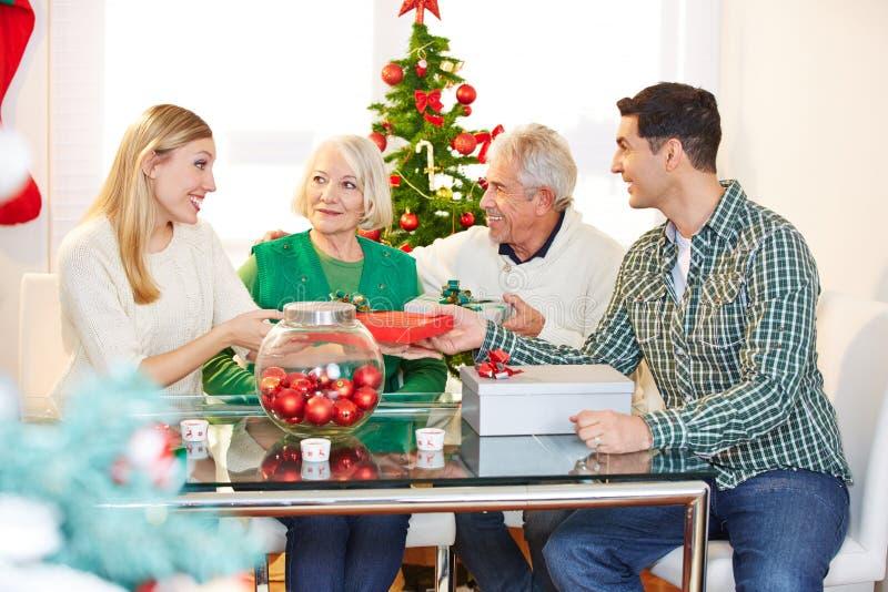 Family celebrating christmas eve royalty free stock photos