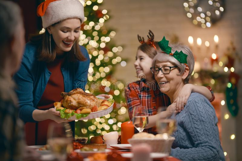 Family celebrating Christmas. Merry Christmas! Happy family are having dinner at home. Celebration holiday and togetherness near tree royalty free stock photography