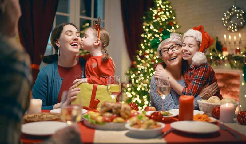Family celebrating Christmas. Merry Christmas! Happy family are having dinner at home. Celebration holiday and togetherness near tree stock photography