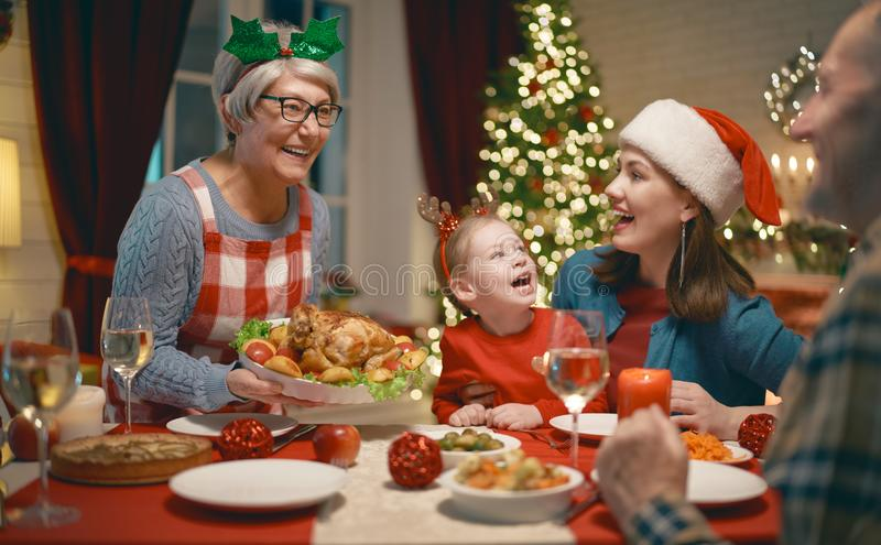 Family celebrating Christmas. Merry Christmas! Happy family are having dinner at home. Celebration holiday and togetherness near tree stock photos