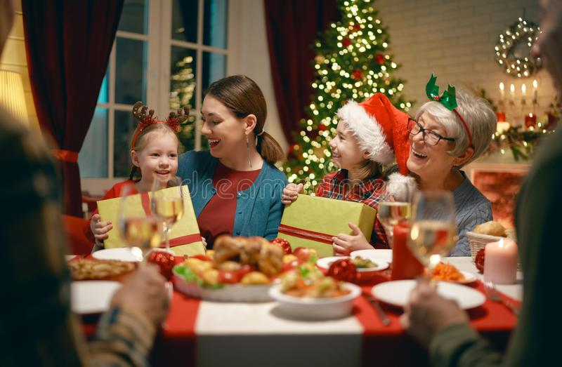 Family celebrating Christmas stock images