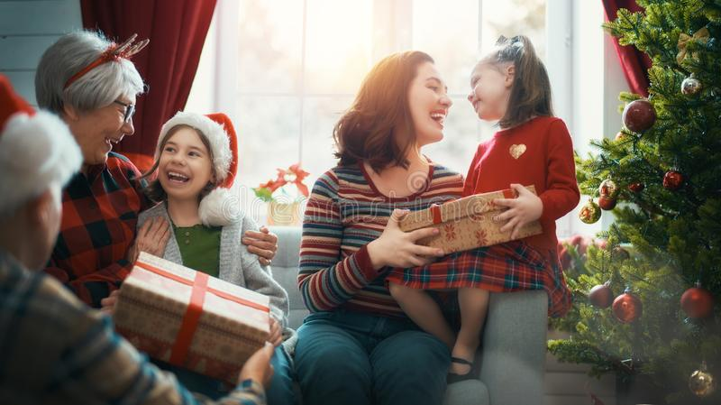 Family celebrating Christmas stock photos