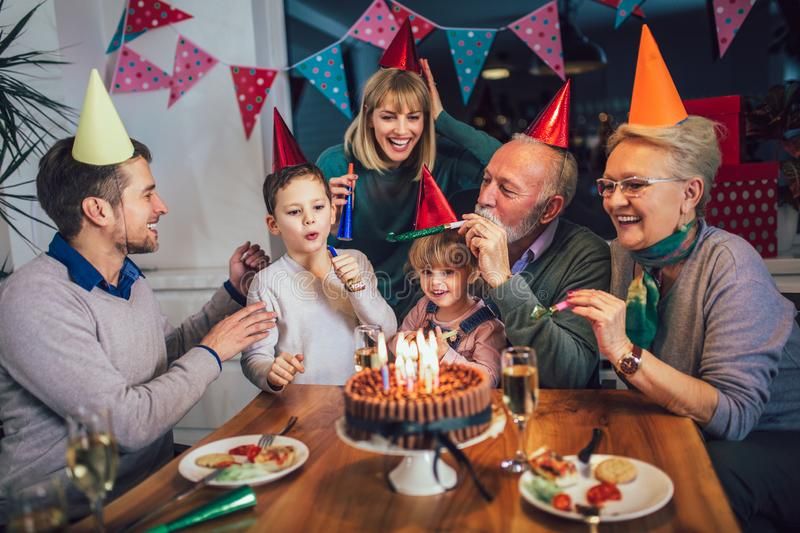 Family celebrating grandfather`s birthday. Together royalty free stock photography