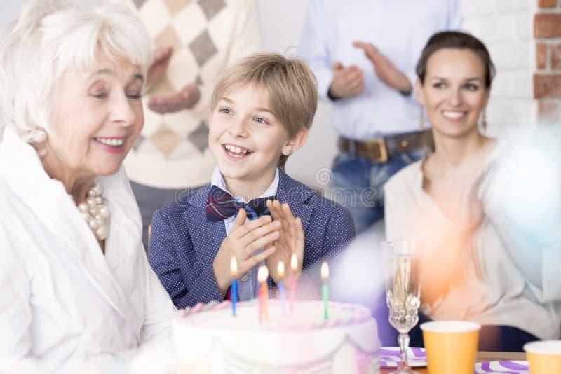 Family celebrating grandma`s birthday stock photography