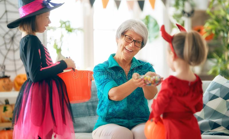 Family celebrating Halloween royalty free stock photos