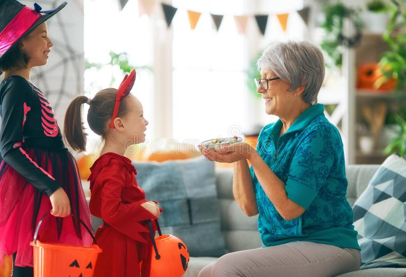 Family celebrating Halloween stock photography