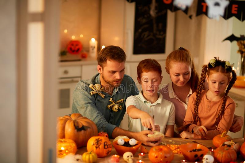 Family celebrating Halloween holiday stock image