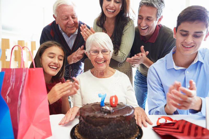Family Celebrating 70th Birthday Together. Family Celebrating 70th Birthday Clapping Hands Smiling stock photos