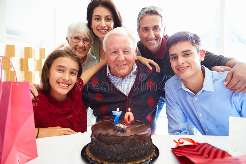 Family Celebrating 70th Birthday Together. Smiling At Camera stock image