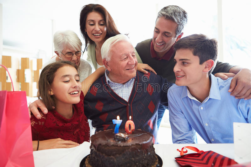 Family Celebrating 70th Birthday Together. Smiling At Each Other royalty free stock photography