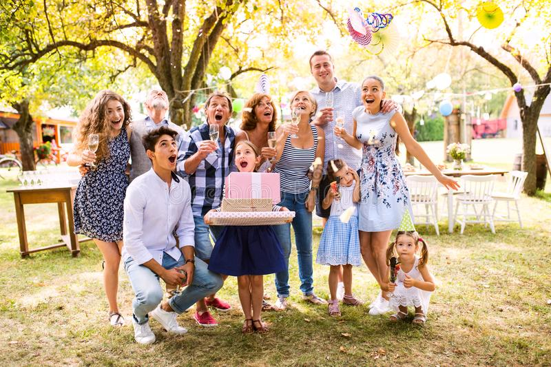 Family celebration or a garden party outside in the backyard. stock image