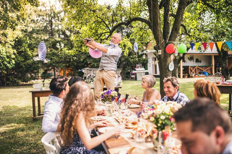 Family celebration or a garden party outside in the backyard. stock photography