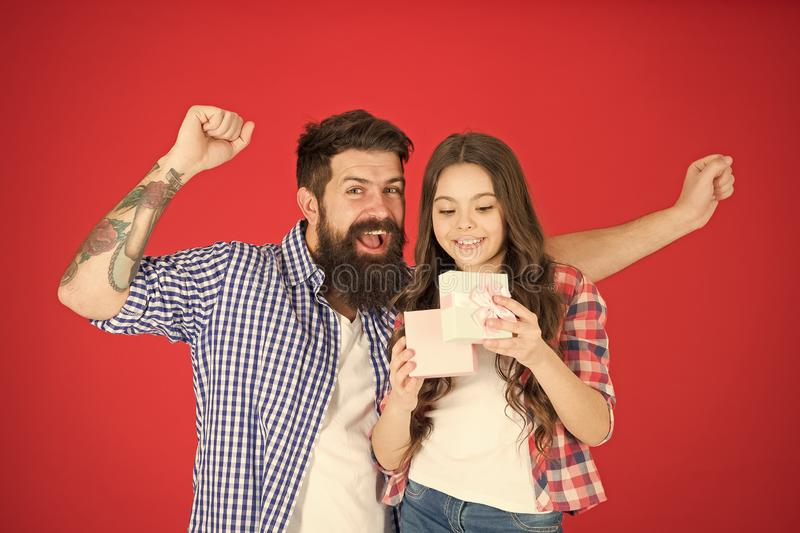Family celebration. Man bearded father and cute little girl daughter red background. Celebrate fathers day. Family royalty free stock photos