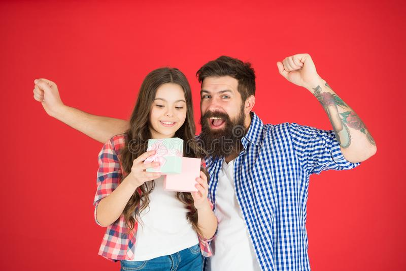 Family celebration. Man bearded father and cute little girl daughter red background. Celebrate fathers day. Family stock photos